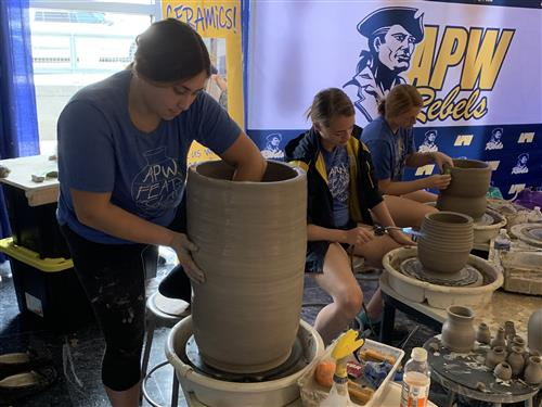 Ceramics students working at convention