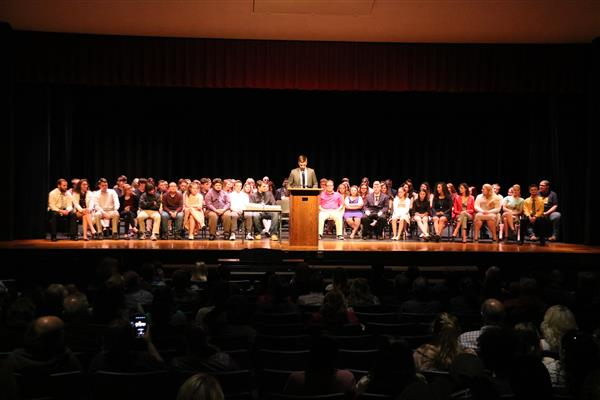 Seniors sit on stage for the senior awards ceremony
